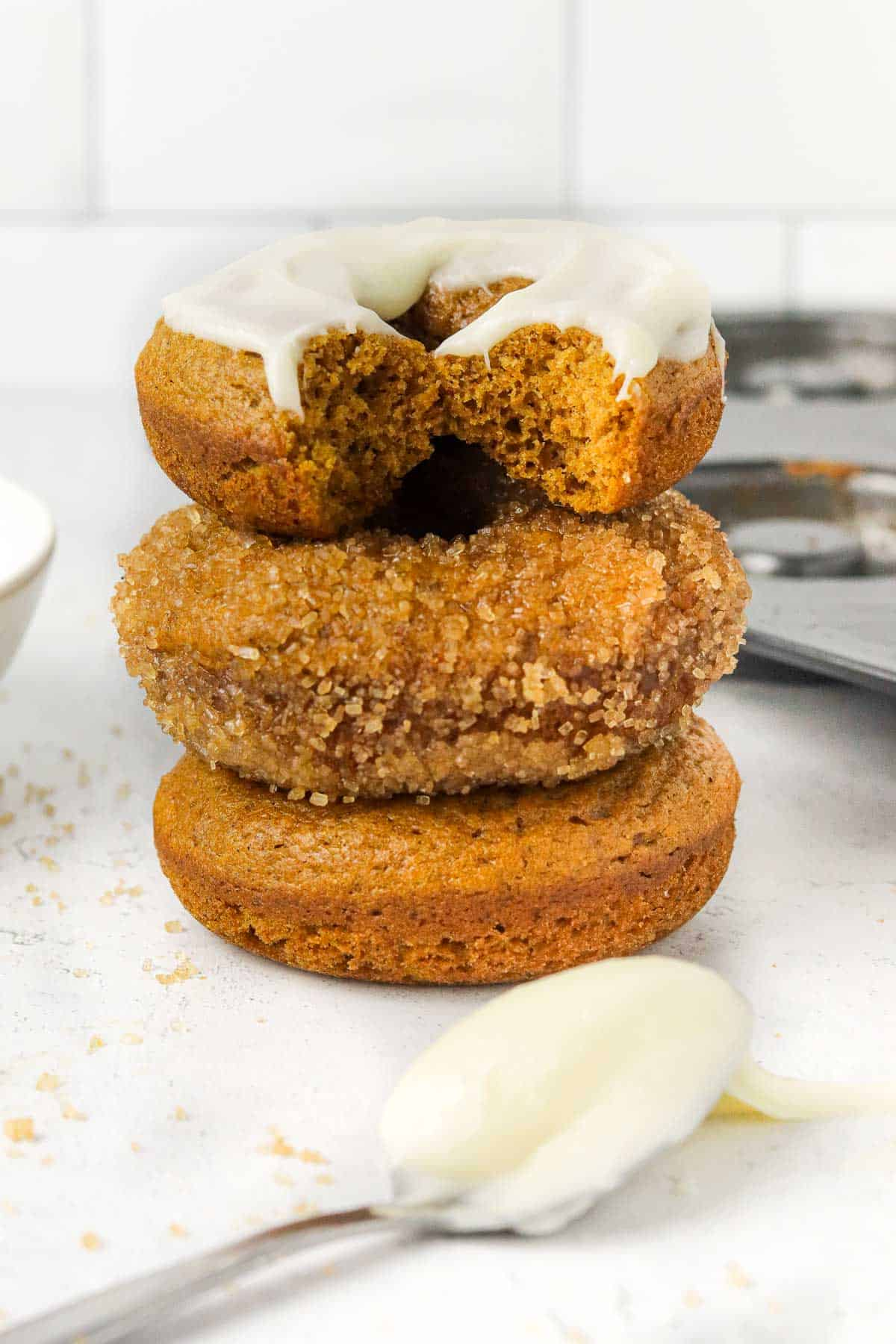 stacked baked pumpkin donuts.