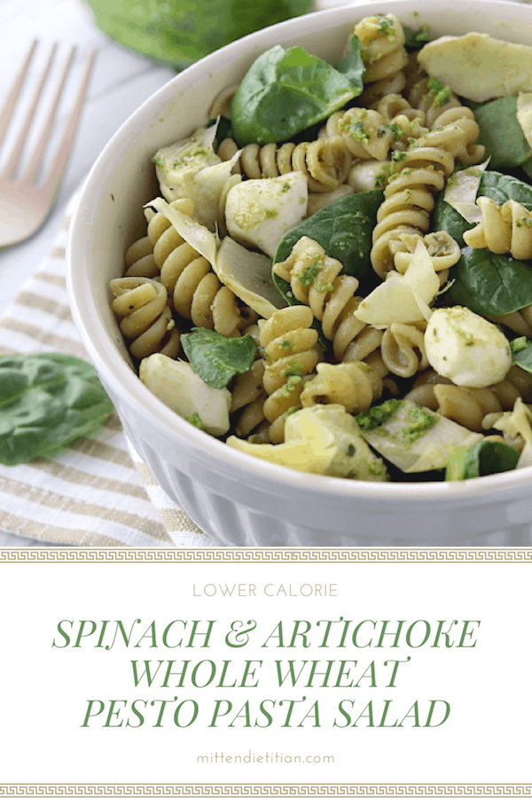 This spinach and artichoke whole wheat pesto pasta salad has about HALF of the calories of regular versions!