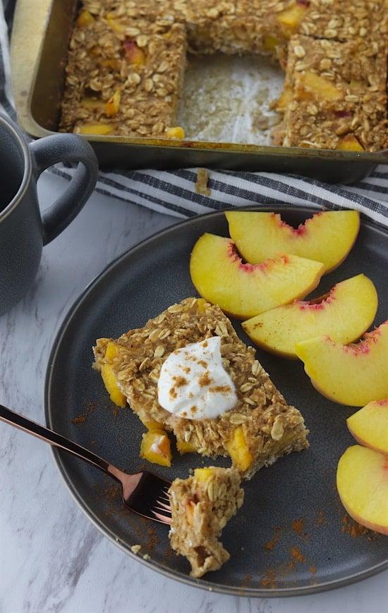 cinnamon peach bakes oatmeal on a plate