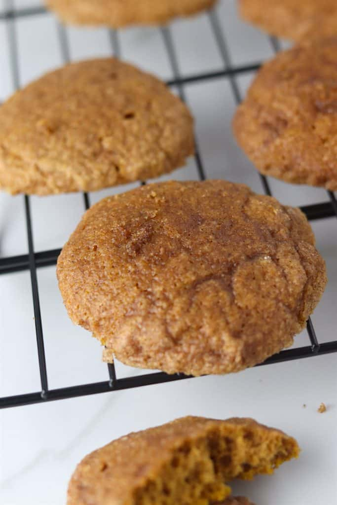 soft baked pumpkin snickerdoodles on a cooling rack