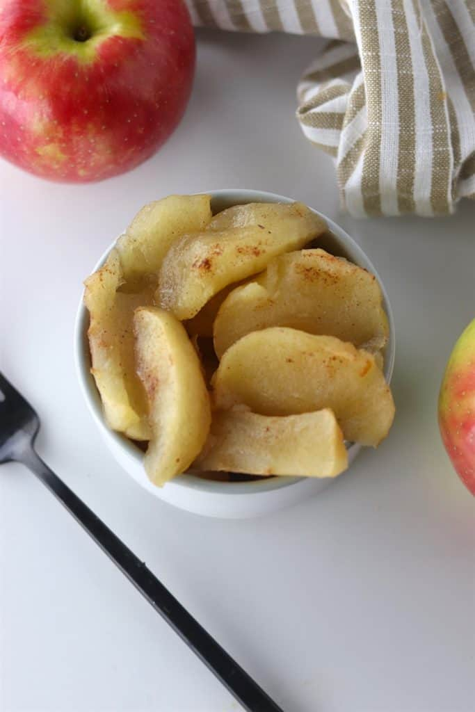 Warm crockpot baked apples in a bowl