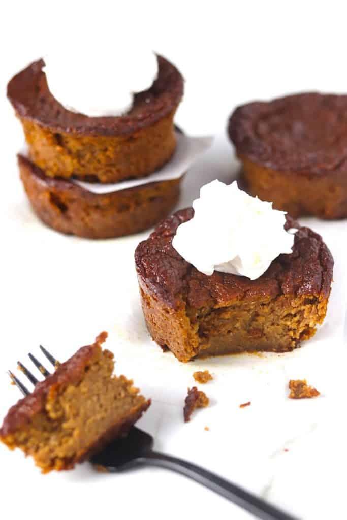gluten & dairy free mini pumpkin pies eaten with a fork