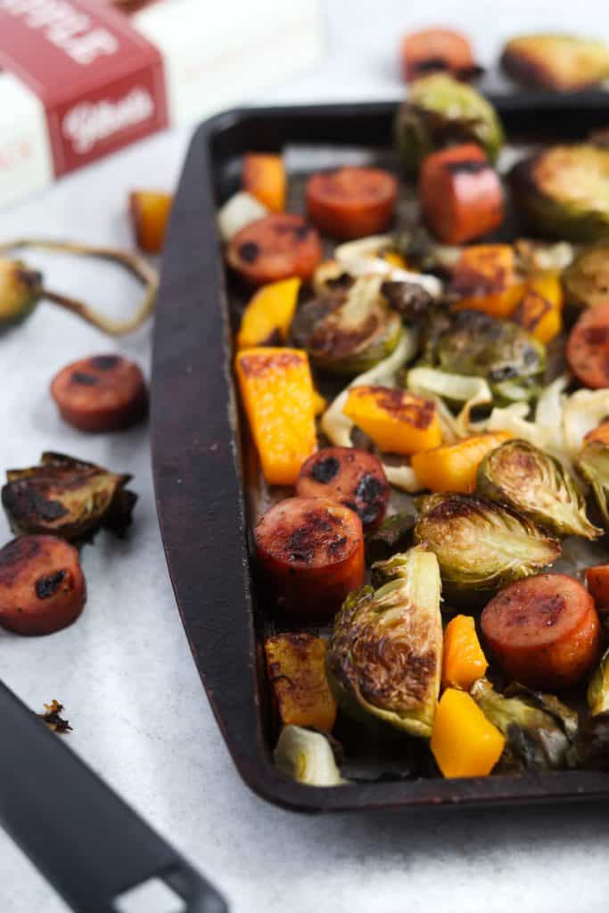 This sheet pan butternut, brussels, and sausage dinner will be your weeknight life saver! Quick, easy and next to no dishes!