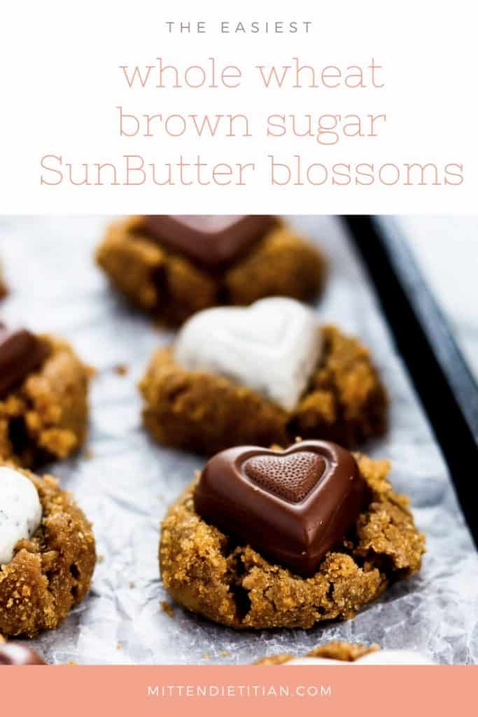 These simple whole wheat brown sugar SunButter blossoms with knock your socks off!! They're perfect for Valentine's day when you use a chocolate heart! #valentinesday #valentinestreat #cookierecipe #blossomcookie