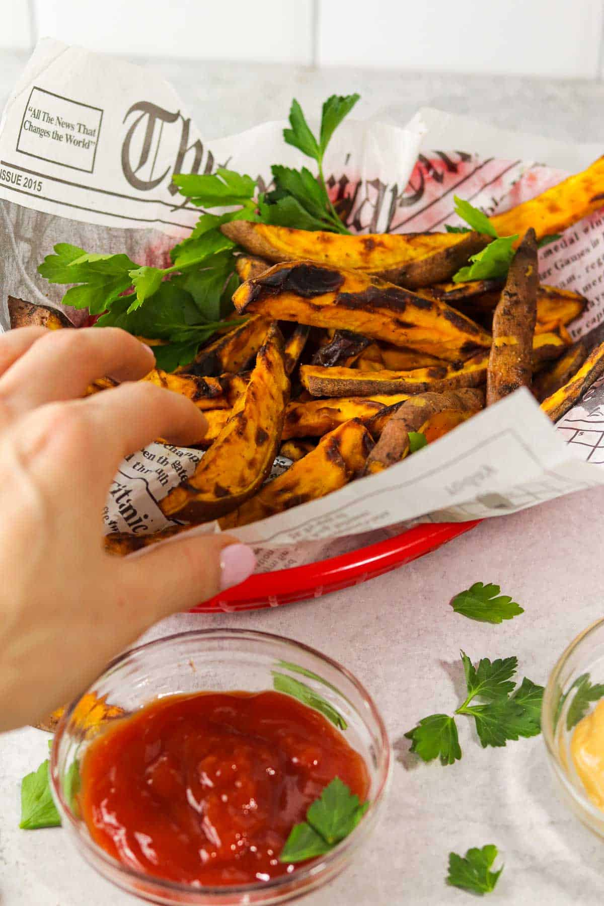 grabbing air fryer sweet potato fries.