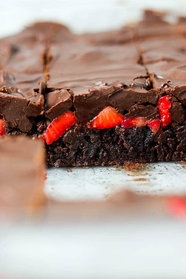 Side angle of layered chocolate covered strawberry brownies.