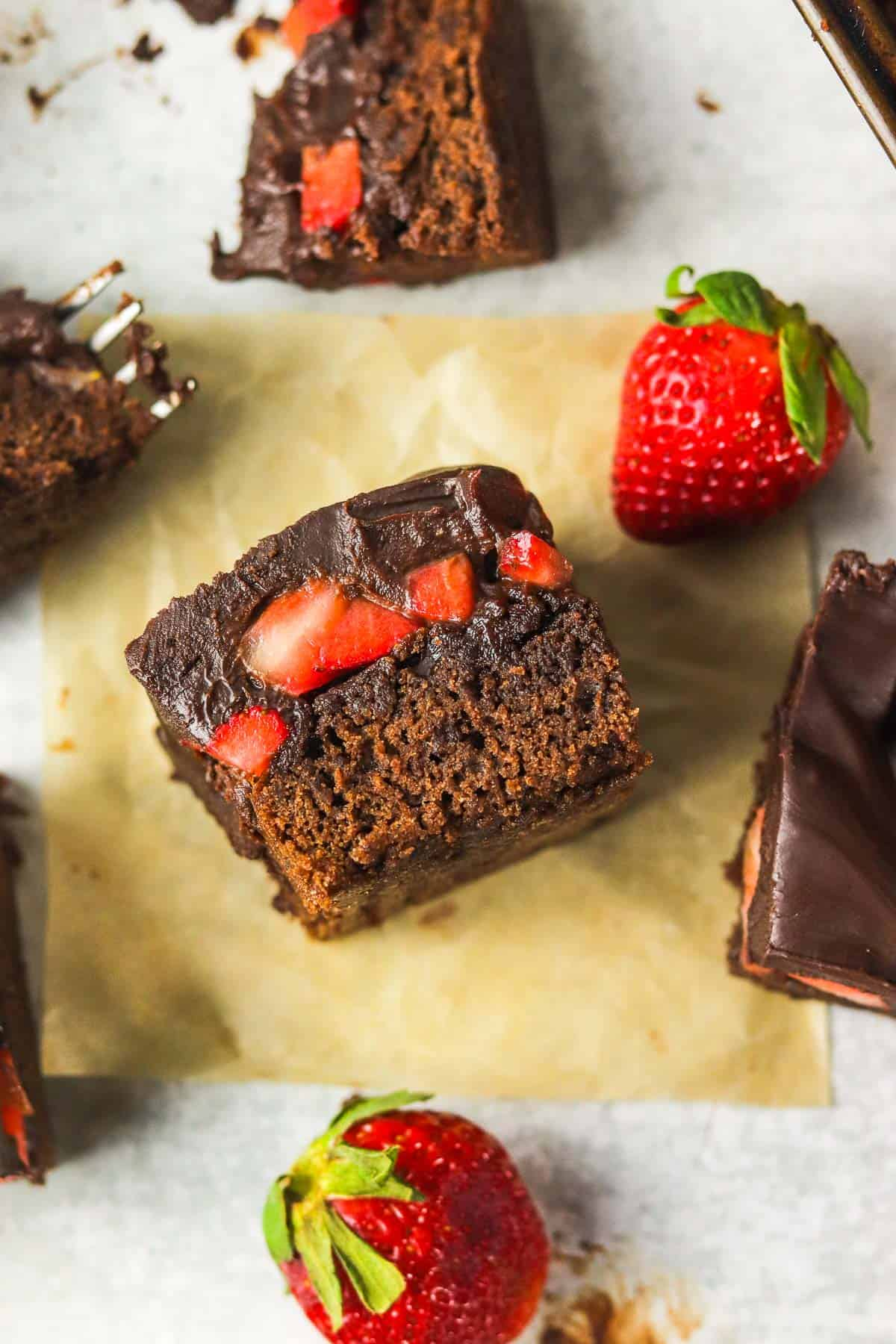 chocolate covered strawberry brownie on it's side.