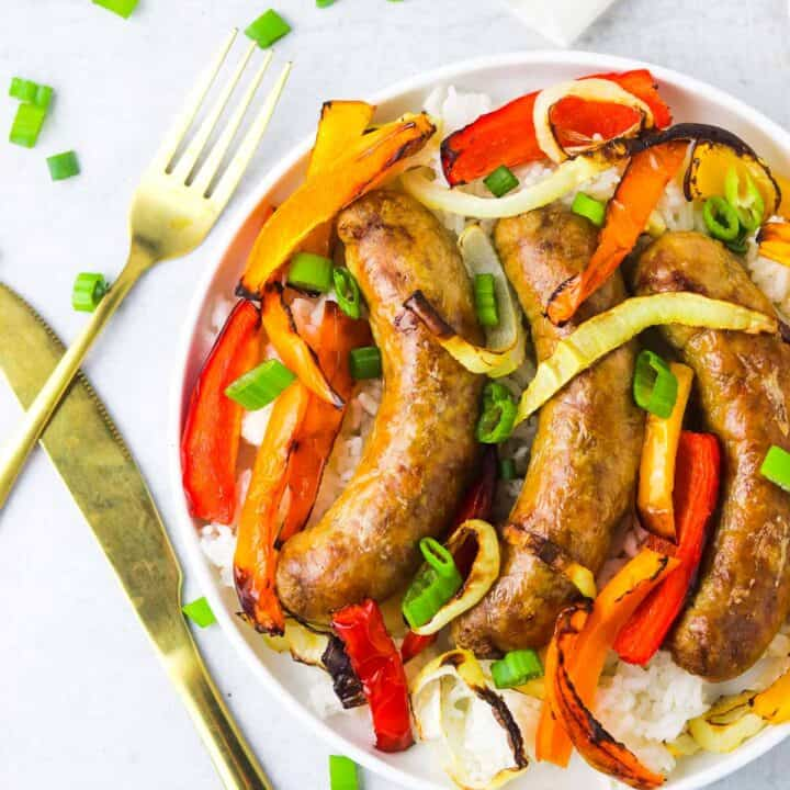 plate of air fryer sausage and pepper with gold silverware
