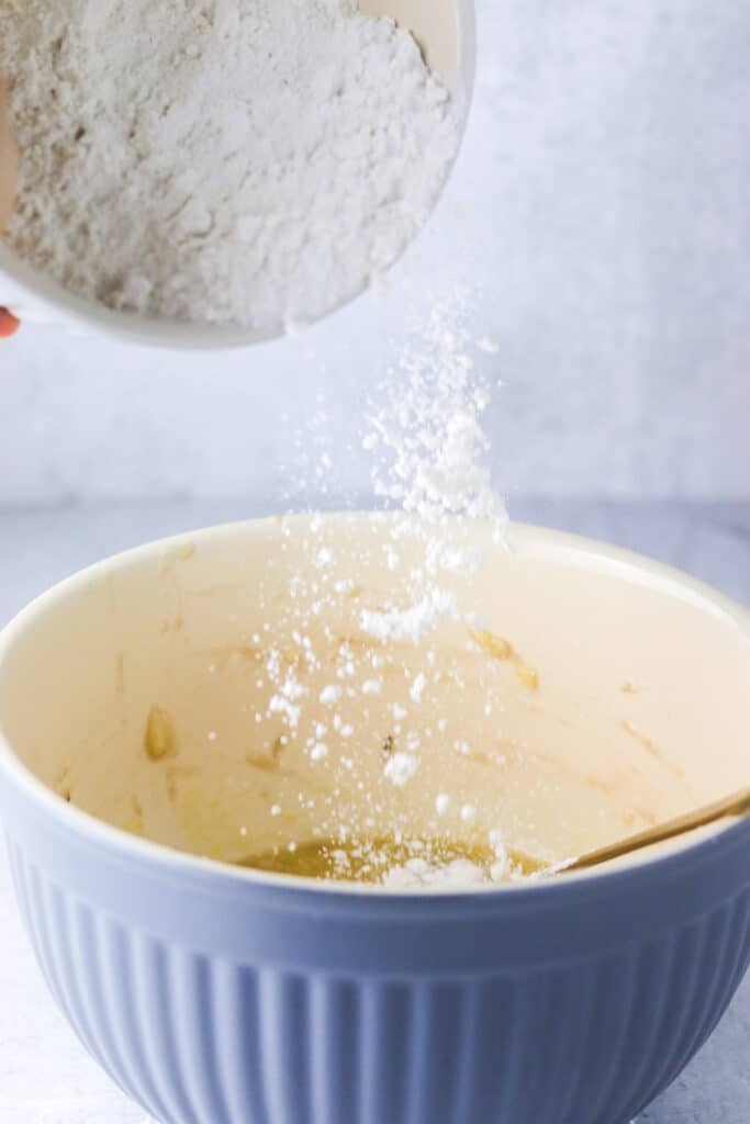 baked banana donuts flour being poured