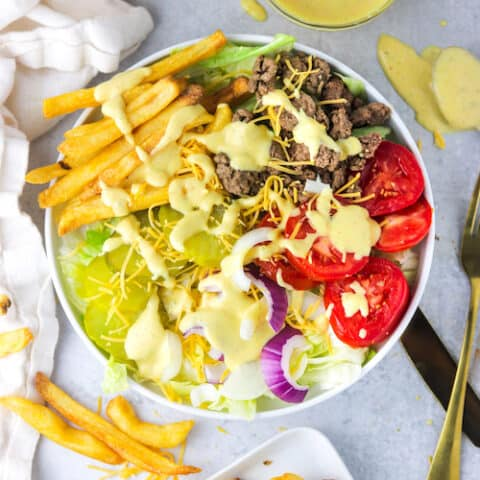 big mac in a bowl top with big mac sauce