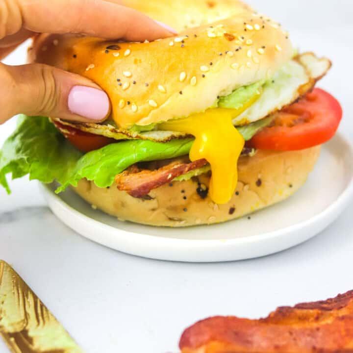 BLT bagel sandwich oozying yolk