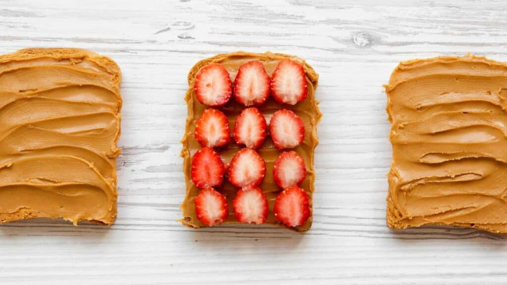 peanut butter with palm oil or peanut butter without palm oil on toast with strawberries