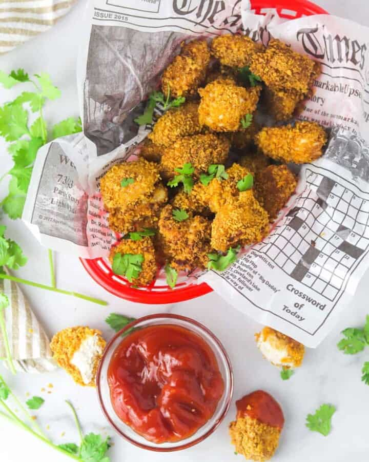 extra crispy spicy chicken nuggets in a basket with ketchup