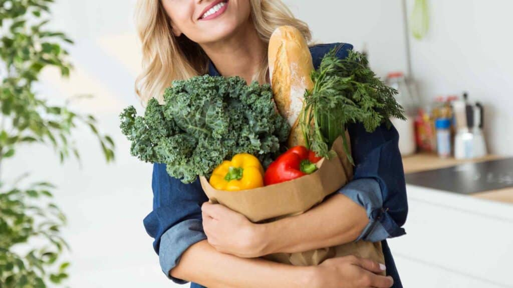 woman holding a bag of produce