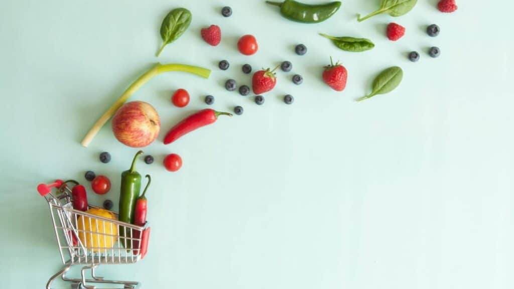 veggies coming out of a cart budget meal planning