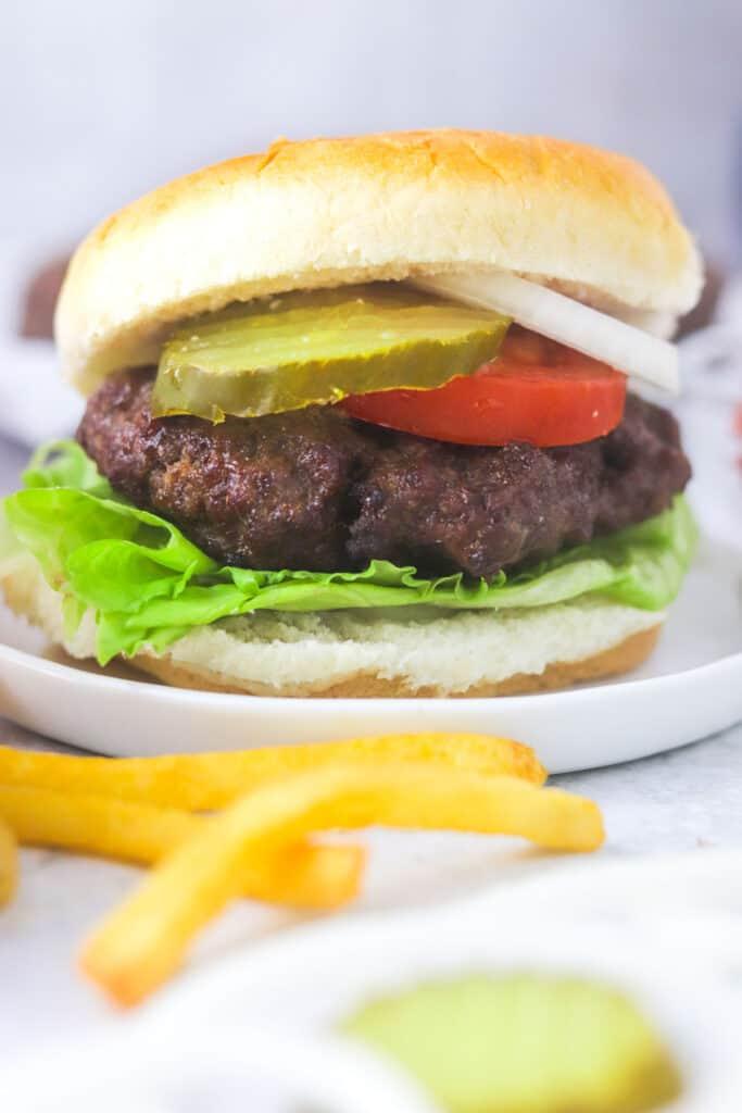 juicy air fryer burger patty on a bun