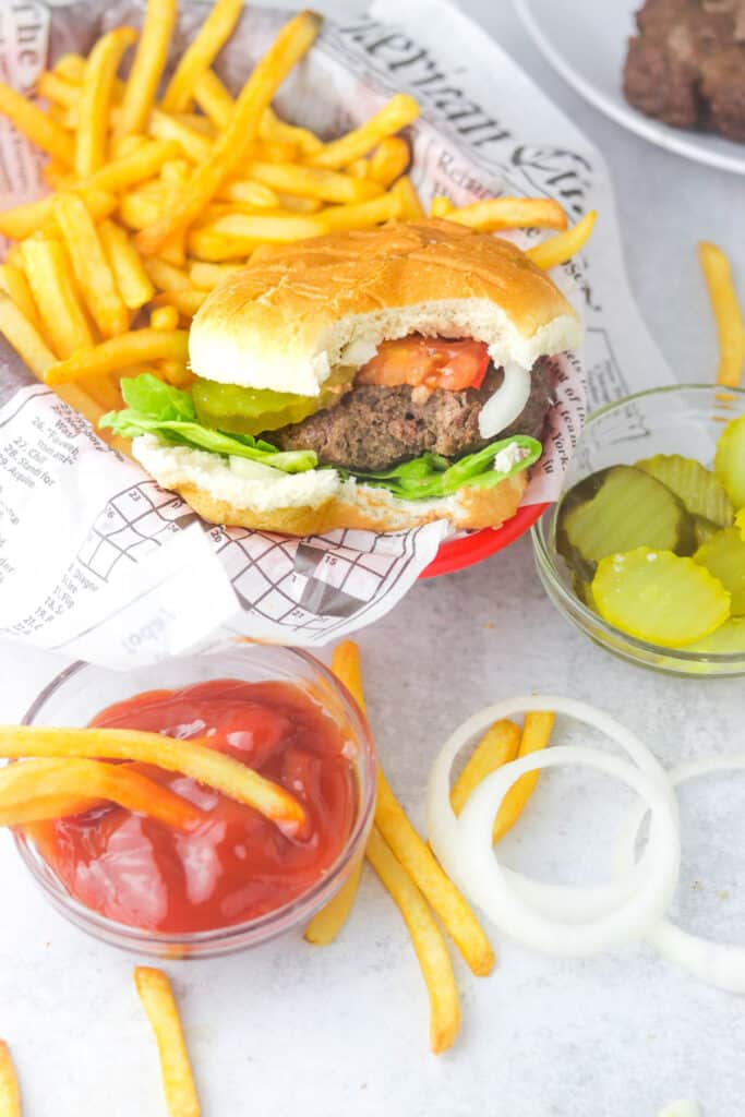 bitten juicy air fryer burger patty with fries
