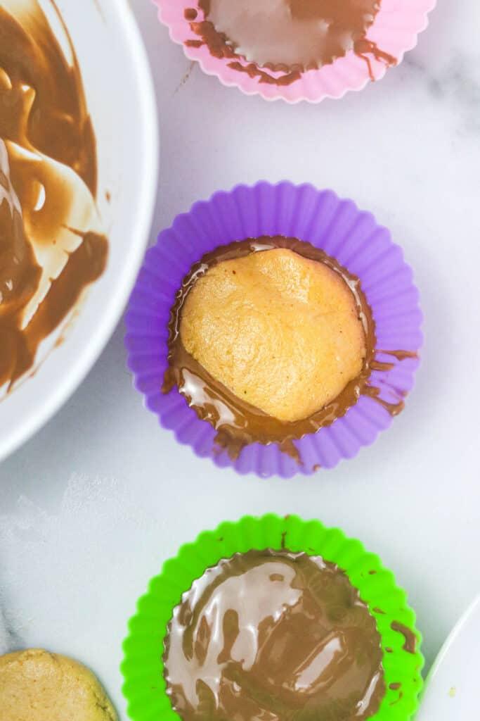 assembling Homemade peanut butter cup perfect bar