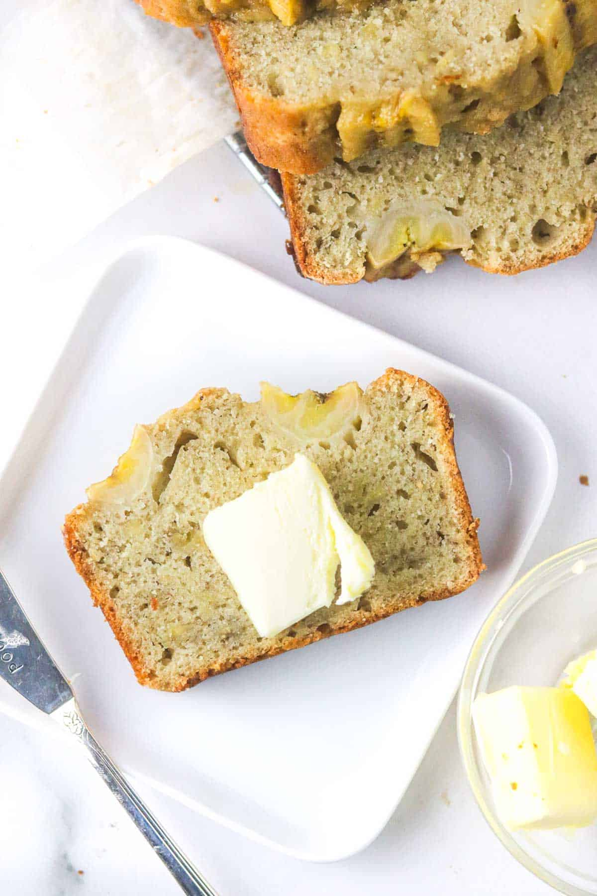 butter on a slice of dairy free banana bread