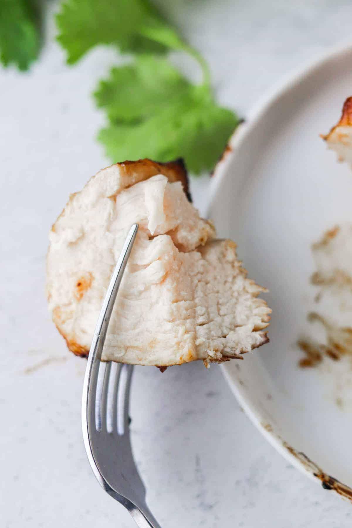 piece of air fryer bbq chicken on a fork