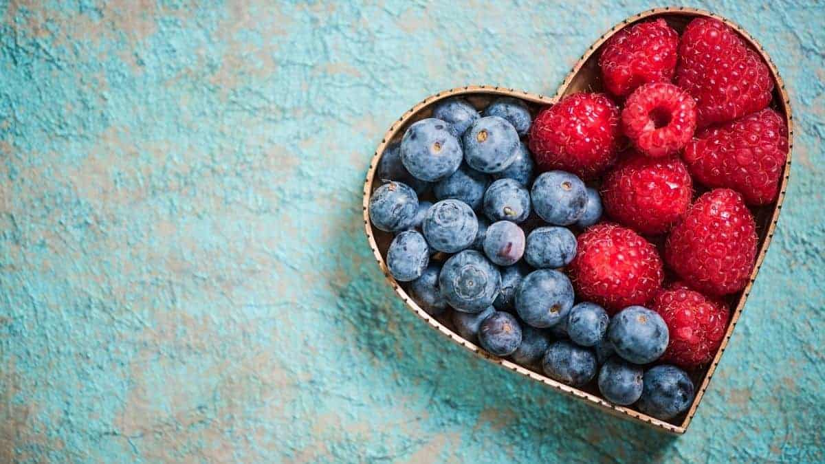 Berries in heart shaped container for gut health.