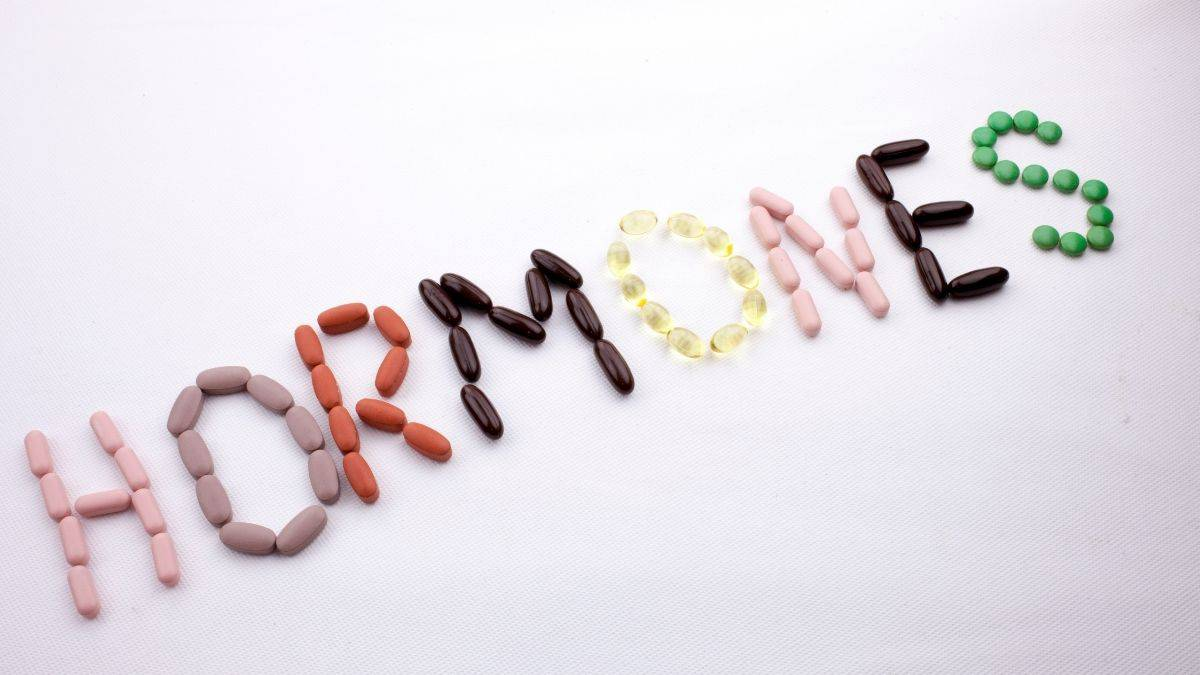 hormones spelled out with pills.