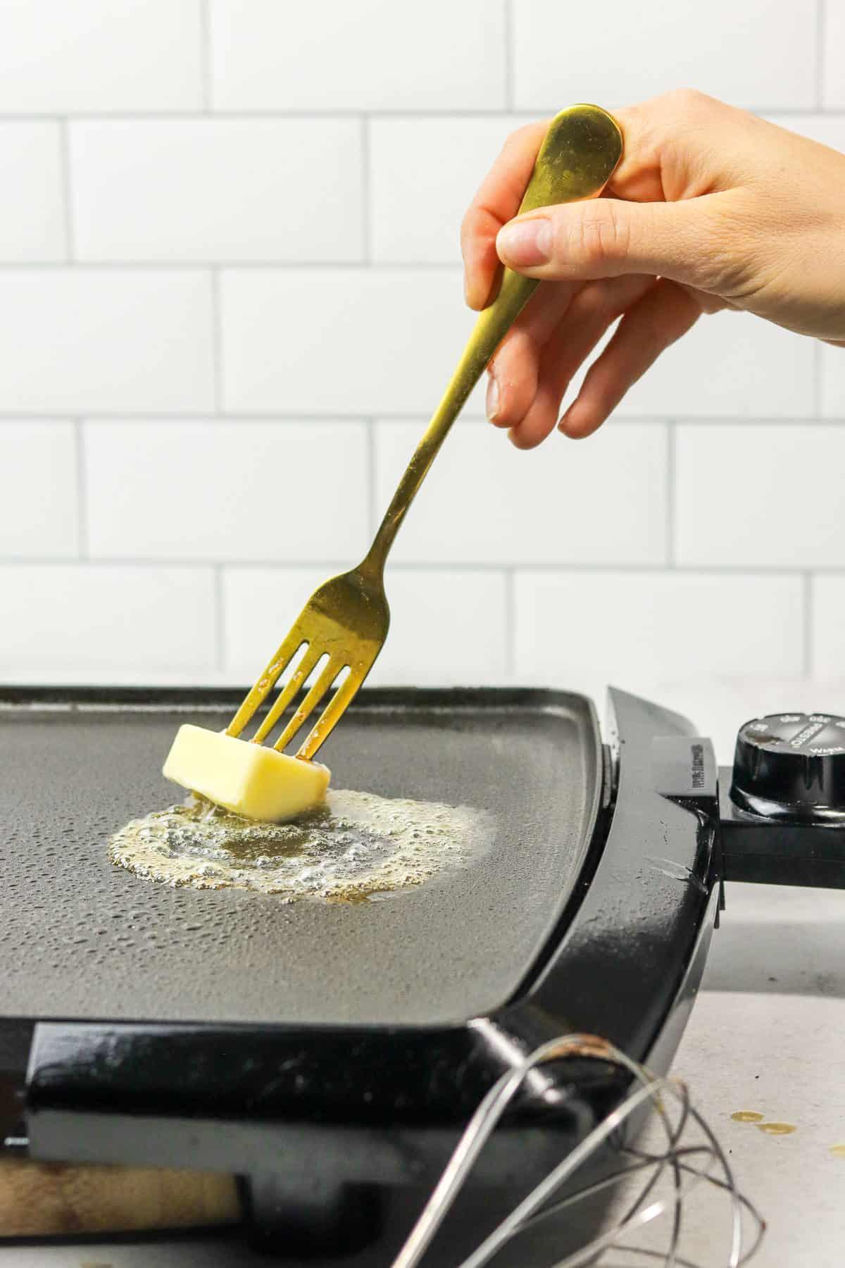 melting butter on a hot griddle.