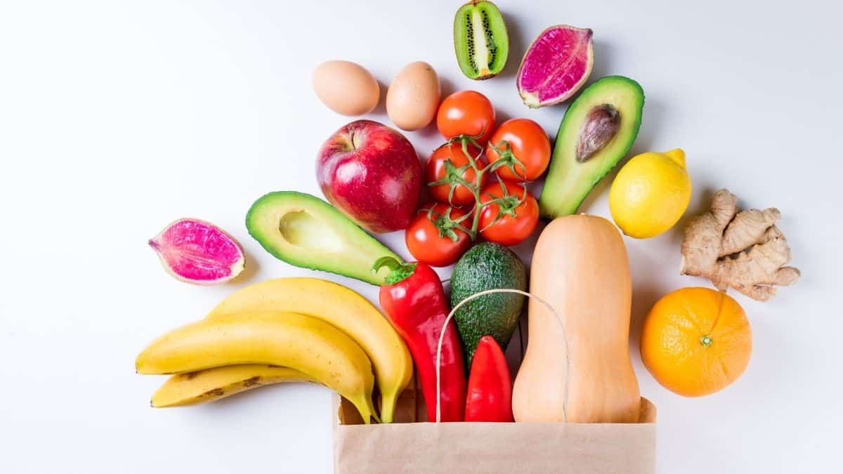 Variety of nourishing foods in a grocery bag.