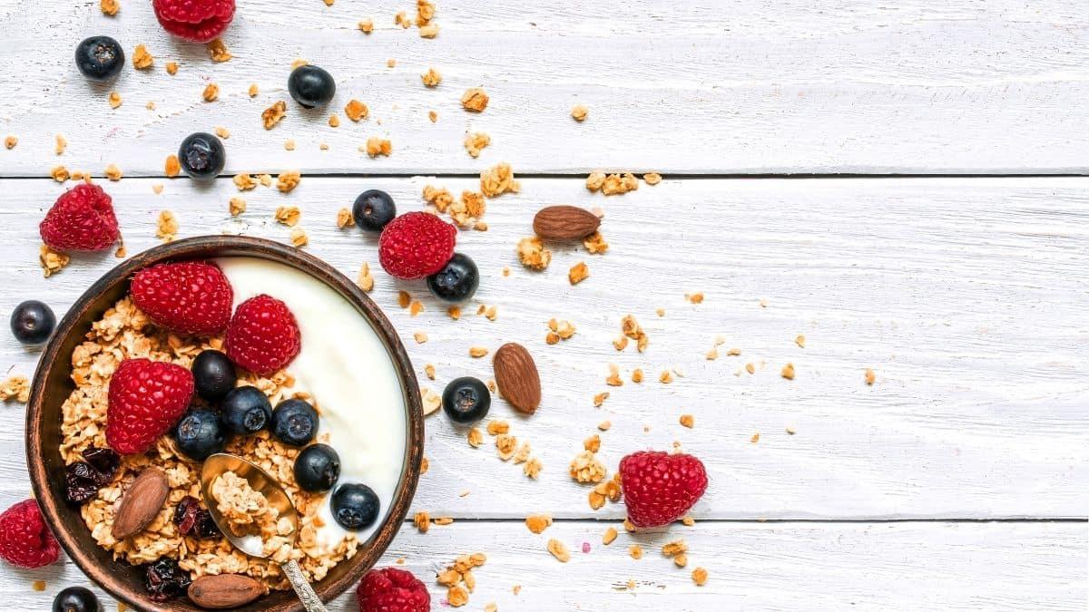 a bowl of yogurt, granola and berries.