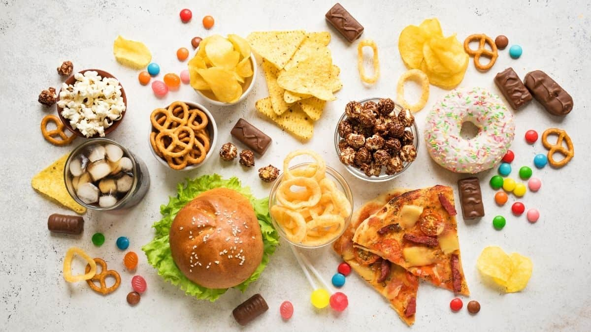 "A variety of ""unhealthy\"" or \""junk\"" food on a table."