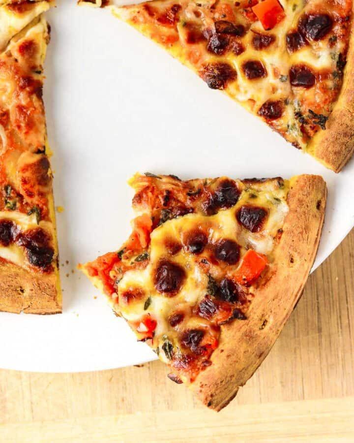 close up half eaten air fryer frozen pizza slice.