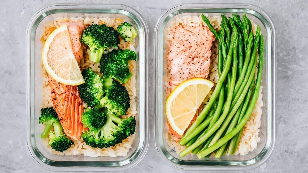 two containers of meal prepped salmon, rice and veggies