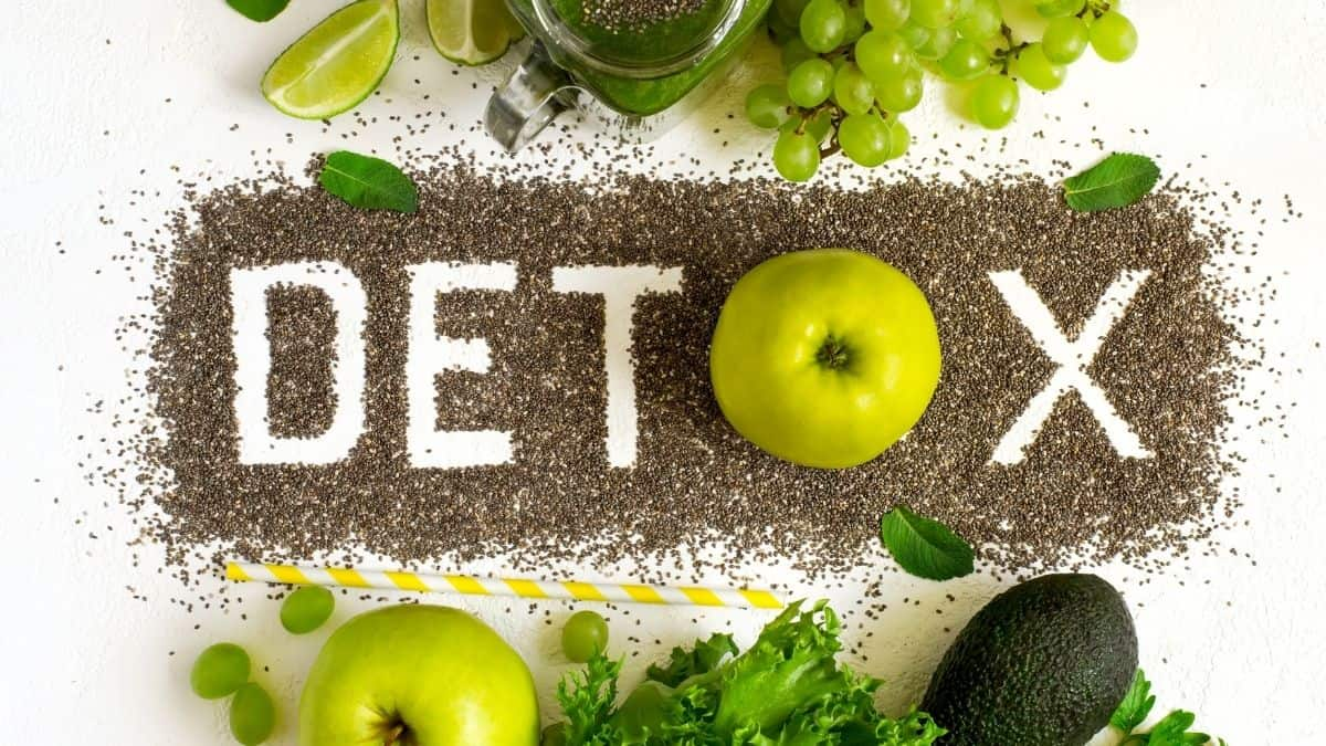 detox spelled out with seeds, apples, grapes and limes.