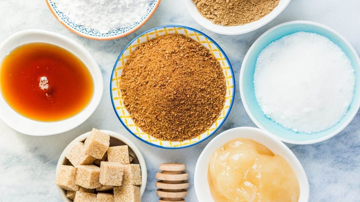 Different types of refined and unrefined sugar in bowls,
