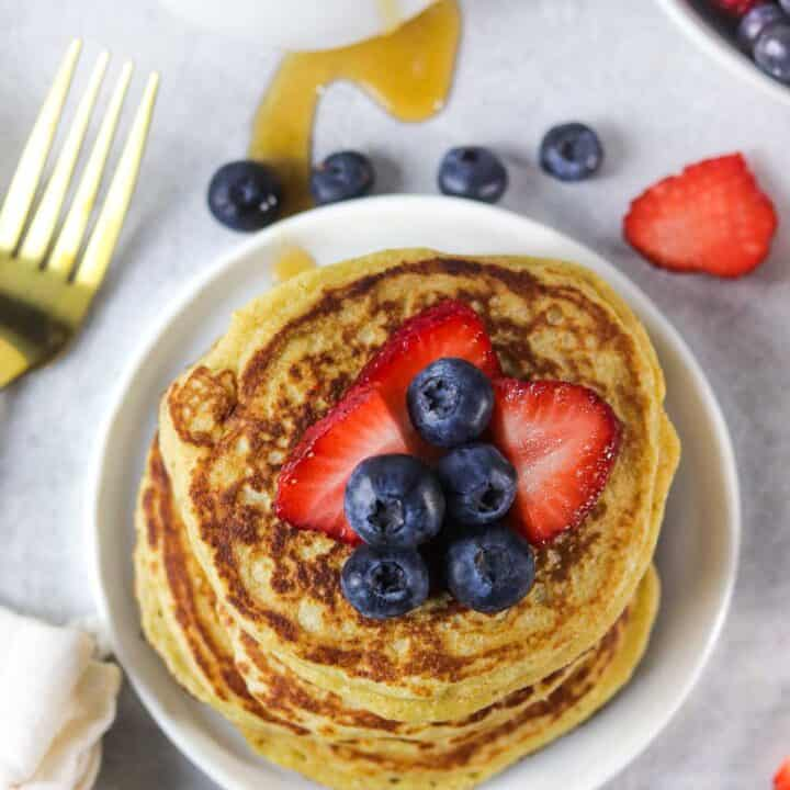 stack of protein pancakes without protein powder with berries.
