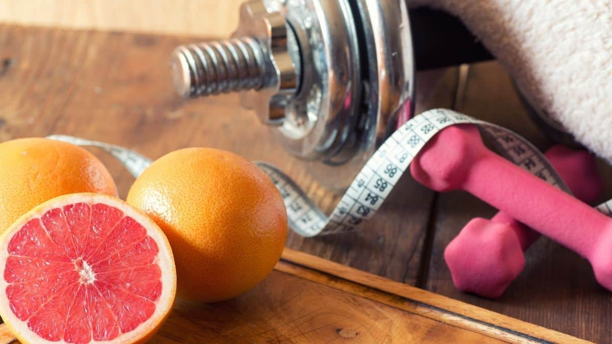 grapefruit and weights with a tape measure.