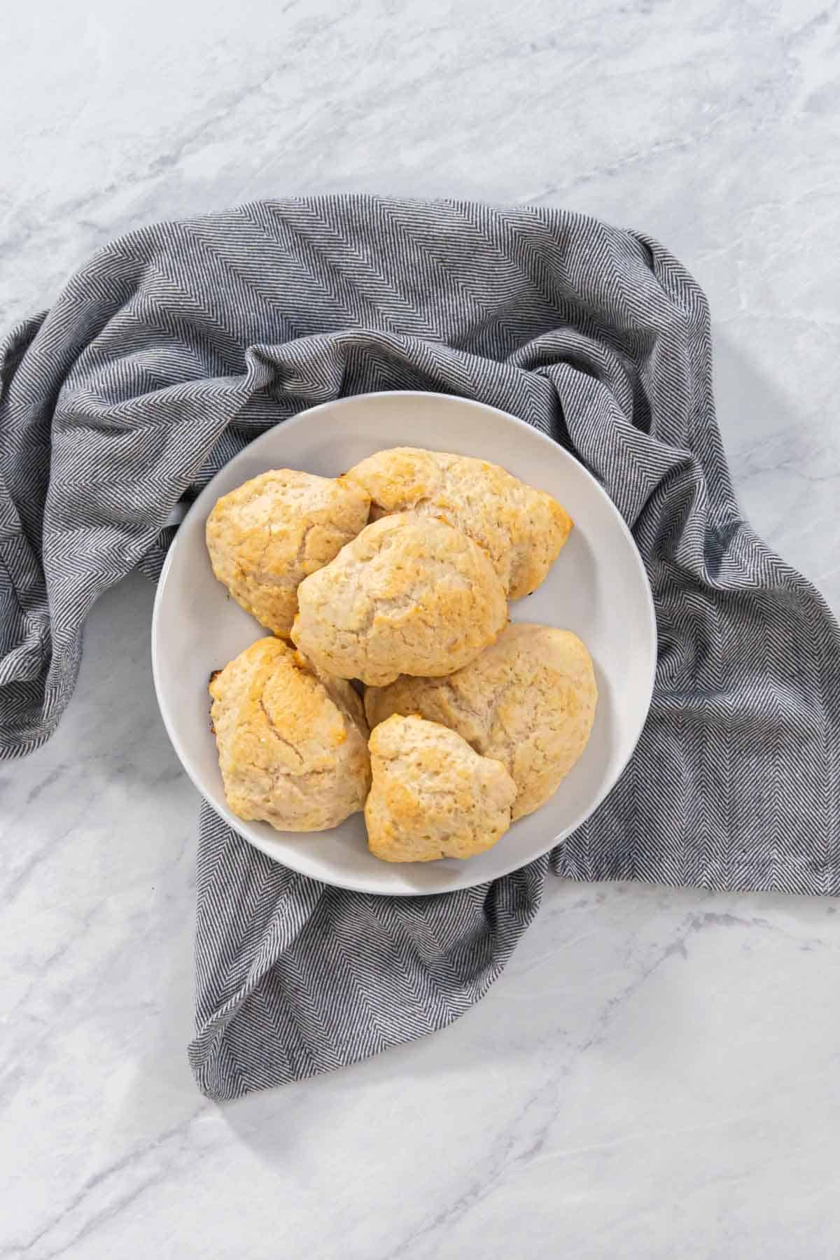 3 ingredient scones on a plate with a gray napkin.