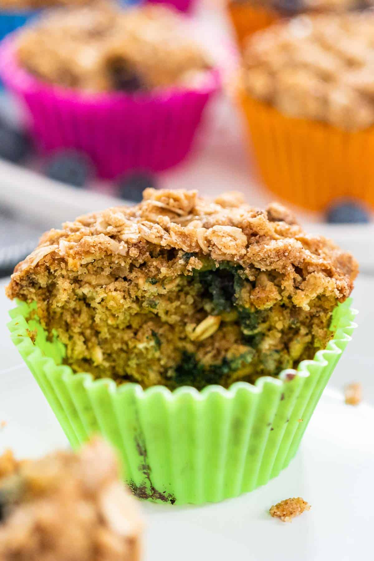 Blueberry oat muffin in a green liner.
