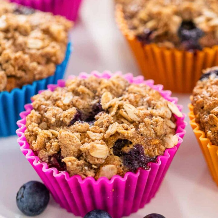 blueberry banana oat muffin in a pink liner.