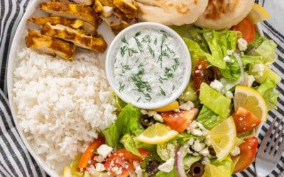 Up close chicken shawarma plate with a striped napkin.