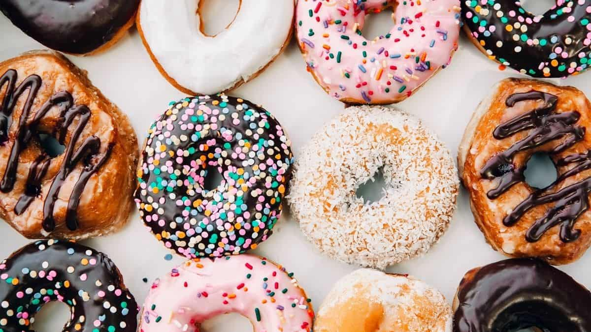 a variety of colorful donuts, an example of food prohibited on the slow carb diet.