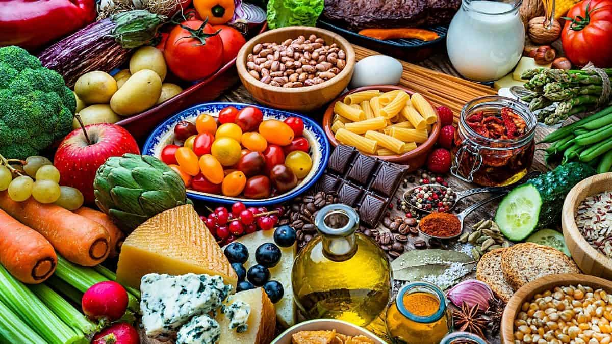 a variety of colorful foods including fruits, veggies and smart carbs.