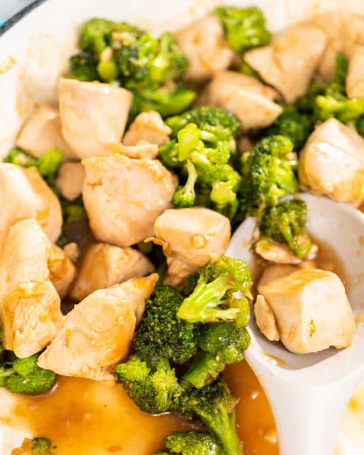 A close up of Easy Broccoli Chicken Stir Fry in a ceramic pot.