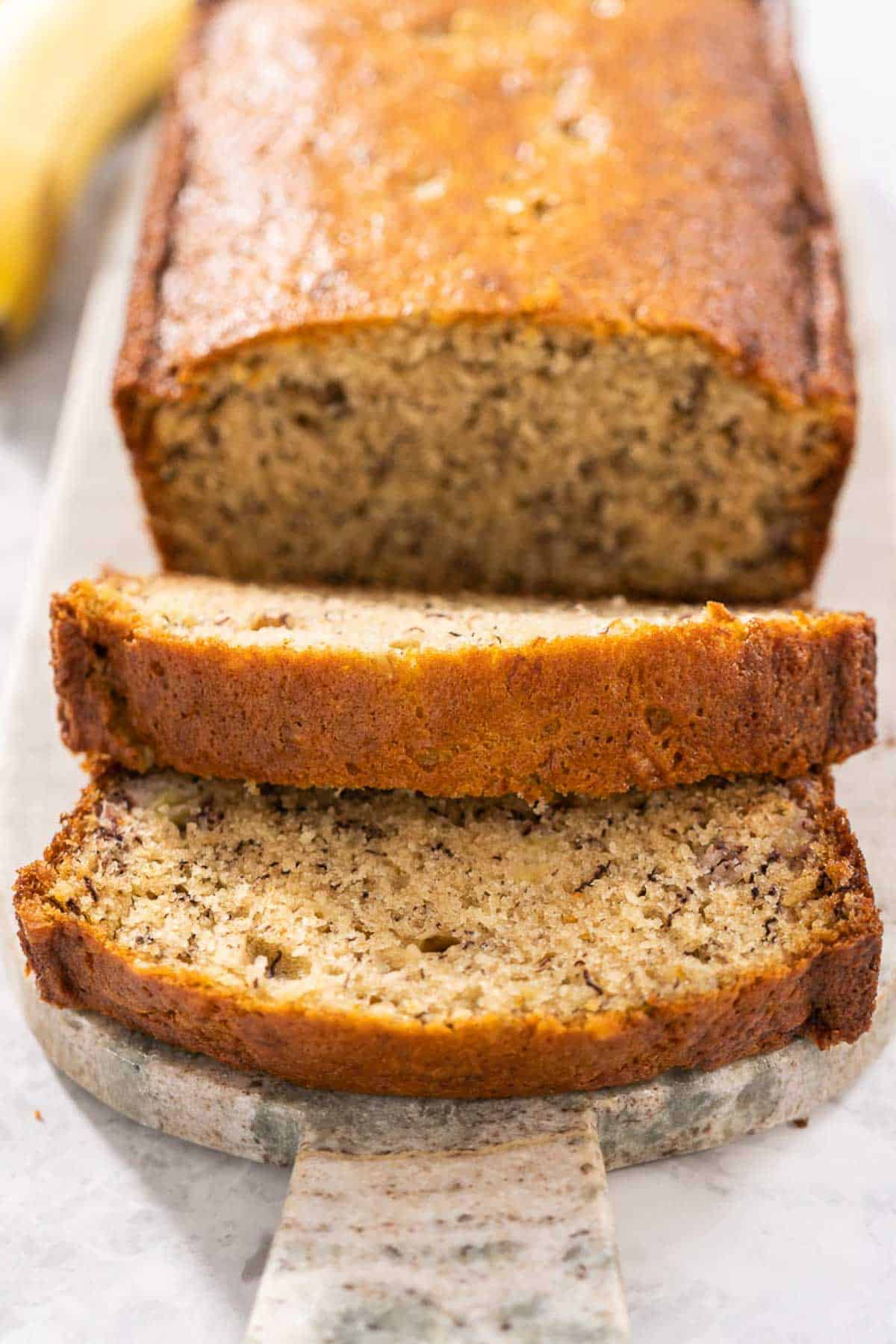 A sliced loaf of one bowl banana bread.