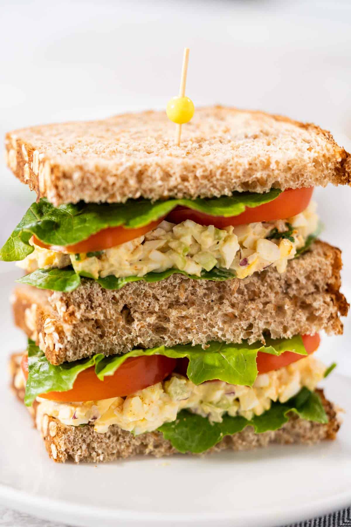 Instant Pot Egg Salad on wheat bread with tomato and lettuce.